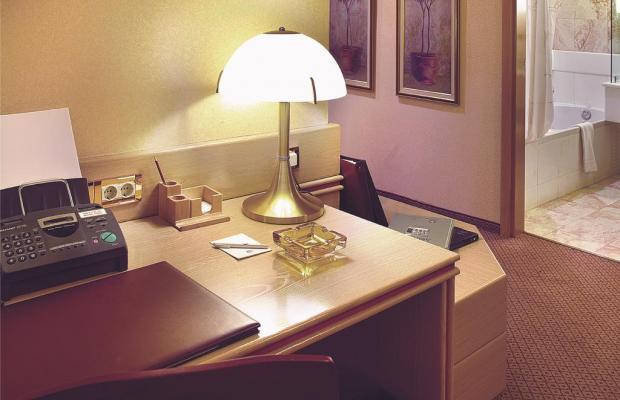 фотографии отеля Holiday Suites изображение №15